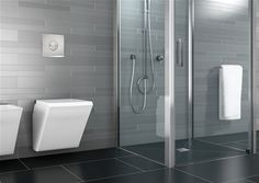 Elegant white and grey bathroom with the Olifilo drainage shower system _
