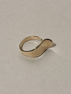 With a gentle curve that mimics the line of your knuckle, this gold ring was inspired by the lines of a lily. * ring face measures: wide * solid yellow gold * made in New York City This item is made to order and ships weeks from the date of purchase. 60s Jewelry, Modern Jewelry, Jewelry Box, Silver Jewelry, Jewelry Accessories, Vintage Jewelry, Jewlery, Fashion Accessories, Jewelry Design
