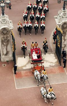Prince William Duke of Cambridge and Catherine Duchess of Cambridge approach Buckingham Palace by carriage procession following their marriage at Westminster Abbey.