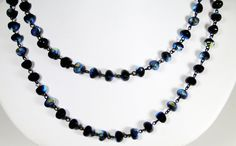 Handcrafted Jet AB potato shaped glass beads. No clasp. This necklace can be worn hanging loose or with two turns.    Includes: Handcrafted gift box.
