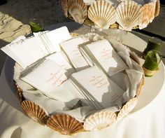 Sun-bleached seashells line a serpentine aisle, reflecting the ocean waves, at this seaside ceremony.