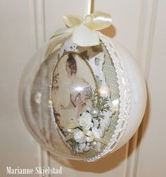 This time I've made a Christmas bulb using two of Pion Design's collections. The bulb can be opened and I've decorated it on the inside. The back is painted white with some glitte…
