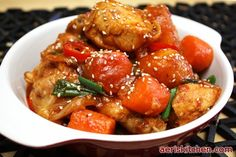 Spicy Chicken BokkEumTang  [1 whole chicken, onion, potato, carrot, spring onion, chillies, red pepper paste, red pepper powder, corn syrup, sesame seeds, sesame oil]
