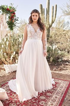 Feel dreamy in this feminine chiffon plus size A-line gown. The illusion V-neckline with lace appliqués on the sleeves make this look romantic. This gown is completed with a chapel length train. Wedding Dress Pictures, Wedding Dress Trends, Boho Wedding Dress, Bridal Lace, Wedding Gowns, Wedding Ideas, October Wedding Dresses, Lgbt Wedding, Wedding Attire
