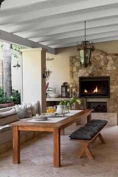 Rustic wood and wicker furniture gives this outdoor living area casual elegance. Clad in stone, the built-in braai creates a striking focal point. Rustic House, Decor, Outdoor Living Rooms, Home, Outdoor Dining, Outdoor Living Areas, Outdoor Garden Furniture, Home Decor, Built In Braai