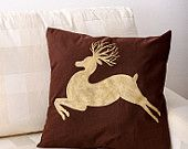 Golden silhouette of a jumping deer on a brown textile pillow Beautiful present for everyone!  Made by Slavica Koceva.