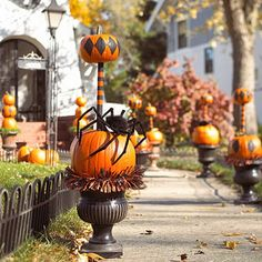 Craft a Pumpkin Topiary: Use wooden dowels -- in Halloween colors, of course -- to securely stack pumpkins into formation: a perfect perch for a lurking spider. Opt for artificial pumpkins if you plan to reuse your towering masterpieces next year. Halloween Spider Decorations, Spider Crafts, Easy Halloween Crafts, Theme Halloween, Outdoor Halloween, Holidays Halloween, Happy Halloween, Halloween Ideas, Halloween Porch