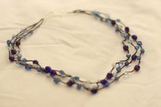 I have had a few requests to explain how I make the beaded crochet necklaces, and I have to admit I was reluctant! Because the work-to-impressiveness ratio is MINISCULE, and I don't want to reveal all my secrets ;) But it's time. Just promise me you'll still ooo and ahhh when I post one! The technique is actually super simple and straightforward. The secret is in the materials! I should note here that I am in no way an expert beader/jewelry maker. This is pretty much the only thing I know…