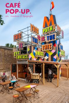 Striking graphics and a multi layered design has been used with this Movement cafe in Greenwich, London #PopupShop #PopUps #RetailPopUps