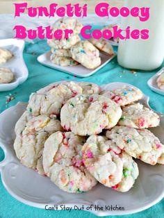 Funfetti Gooey Butter Cookies contain lots of sprinkles! Uses a funfetti cake mix. Cream cheese makes them very moist and gooey.