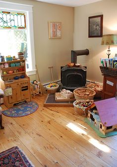 #Waldorf playroom. A few too many items in here for my taste, however love the big baskets for collections of small items. If we didn't have so many collections that I needed to stack them in a cupboard, I would love having them in open baskets.