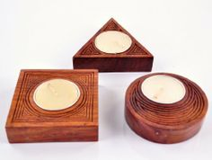 Carved Teak Wood Tea Light Candle Holder Handmade By Artisans by Karmakara. $16.25. The Candle holders are made from solid teak wood.. Dimensions : Triangle : 3 inch x 3 inch x 1 inch. Square : 3 inch x 3 inch x 1 inch. Round : 3 inch diameter and 1 inch high. The holder set is great for Decor and Gifting.. Hand carved by skilled artisans over several days, this is a work of art.. These Tea light holders made of solid teak wood. Hand carved by skilled artisans over several da...