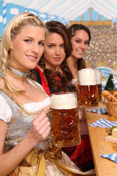 Photo about Brunette and blond bavarian women sitting in a beer tent holding a big beer. Image of laughing, three, glass - 17518670 German Women, German Girls, Octoberfest Girls, German Beer Festival, Curvy Women Outfits, Beer Girl, Beer Lovers, Poses, Root Beer