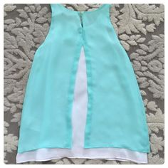 NWT, Banana Republic, Beautiful Aqua & White Top! NWT, Banana Republic, Beautiful Aqua & White Top! Stunning style with a beautiful fit! Lightweight made of 100% polyester. Fully lined with back button closure. Brand new with tags, size XSP. No trades. Banana Republic Tops