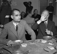 Joachim von Ribbentropp and Rudolf Hess in custody. Von Ribbentrop Shields his face from photographer December Von Ribbentrop was hanged and Hess given a life sentence. Joachim Von Ribbentrop, Bernard Montgomery, Nuremberg Trials, The War Zone, United Press International, World War Ii, Wwii, Germany, Blog