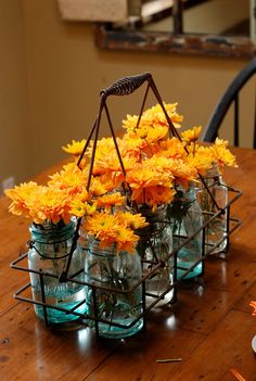 I love everything about this... the happy orange flowers, the vintage milk bottle carrier, the aqua mason jars... LOVE!