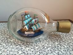 A personal favorite from my Etsy shop https://www.etsy.com/uk/listing/480593471/vintage-ship-in-a-bottle