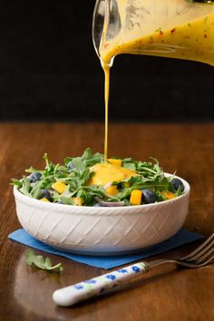 So delicious, super easy and this dressing is the anecdote for boring salads and it's fabulous drizzled over pan-seared or grilled salmon, shrimp or chicken! via salat dressing vinaigrette Sweet and Spicy Mango Salad Dressing Salad Dressing Recipes, Salad Recipes, Salad Dressings, Mango Vinaigrette Recipes, Avocado Recipes, Soup Recipes, Mango Salat, Plat Vegan, Winter Salad