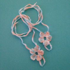 Baby girl barefoot sandals. My own design  Five petal treble flower made with 100% soft acrylic fine yarn in hues of baby pink, blue and white. $4