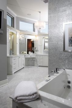 Stainless steel tile.  Great way to bounce light around and add a little luxury: Found at http://www.subwaytileoutlet.com/
