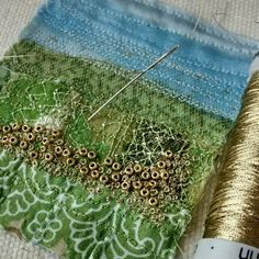 Working on a little fabric landscape in green and gold.
