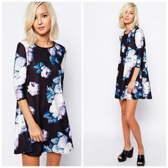 "HPx2 Floral Print Swing Dress River Island dress from ASOS. Tag shows 10 BUT that's UK sizing so the dress is a US size 6. Woven fabric with a crew neckline. Gentle swing pleats. Floral print on front and back of the dress. Regular fit. Approx 31"" in length. 96% polyester and 4% elastane. ❌NO TRADES❌ River Island Dresses"
