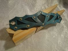 """Shield Silhouette - """"Give Me Thorns"""" adjustable black-turquoise leather steampunk wristlet"""