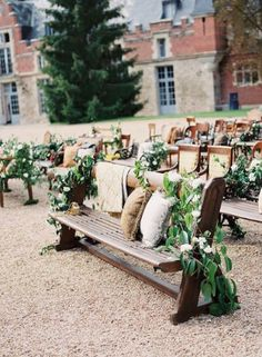 Instead of setting up traditional rows of chairs for the ceremony, opt for benches with throw pillows to create a cozy, friendly atmosphere.