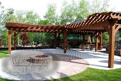 Free standing Gazebo and two Pergolas attached together with Early American stain and Champion profile on pergolas. Custom extended rafters on pergola roofs.