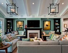 light gray or beige couch with dark wood furniture against light blue walls