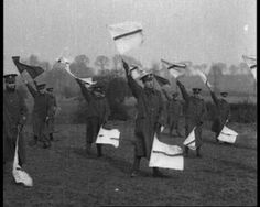 Signal training. View WW1 film: http://www.britishpathe.com/video/training-recruits-signalling-bayoneting