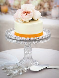 Give each table their own cake to cut, can also use as the table marker with numbers.  Table cakes unexpected wedding cakes  http://wedding.theknot.com/wedding-planning/wedding-cakes/articles/unique-wedding-cake-ideas.aspx?page=3