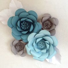Learn how to create these giant paper flowers to form a paper flower backdrop!