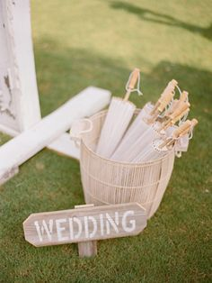 rustic signage and parasols for an outdoor ceremony