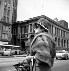 Vivian Maier - Chicago - Michigan Ave and the Chicago Cultural Center in the background.