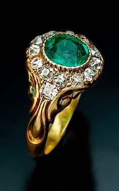 A Victorian Era Emerald and Diamond Gold Ring circa 1850 This Russian mid 19th century carved gold ring is set with an oval old mine emera...