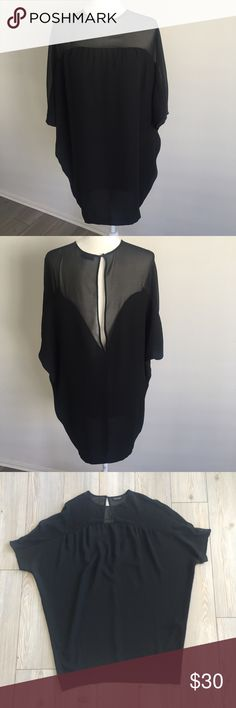 """Topshop Black Tunic with Open Back Size 2 US Black tunic top by Topshop in size 2. Dolman style Top so it has a looser fit. Armpit hole to armpit hole measures approximately 29"""" across, approximately 32"""" in length. Sheer upper with split back detailing and button and hook closure at back. 100% polyester. In excellent used condition! Topshop Tops Tunics"""