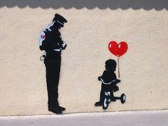 bansky bicycle   banksy-Policeman & girl on bike