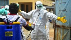 Guinean health workers wearing protective suits at a hospital in Conakry - 14 September 2014 - Going into disease infected areas means risking their life to save lives. Yet most of these workers are volunteers, giving their time and risking it all for no recompense for their fellow humans. True heroes.