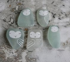 Painted Sea glass Owls.. I have so much sea glass art projects from childhood, never thought to paint it before :)