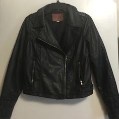 Miss London faux leather jacket Hits above the waist. Has silver ball accents on the shoulder. Small wear and tear on one side of collar. Miss london  Jackets & Coats Utility Jackets