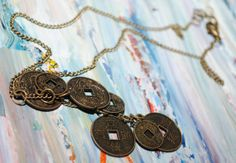 Short asian charm necklace w/round coins by AbstractionsbyCC, $17.00