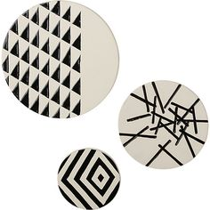 8a) 3-piece marlow ceramic disc set to be placed on wall above kitchen bar counter. $69.95 for all three from CB2.