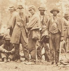 Details from a photograph of Confederate prisoners captured during the Overland Campaign, White House Landing, Virginia, June 1864. Source.