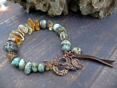 As Real as the Land they Ride - OOAK citrine african turquoise gem copper leather artisan lampwork rustic boho bracelet by PreciousViolet on Etsy https://www.etsy.com/listing/256244988/as-real-as-the-land-they-ride-ooak