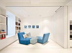 Fancy Blue Sofa And Sleeper Sofa At The Hidden Family Room University Place Studiolab Decorated With Open And Mounted Wall Storage