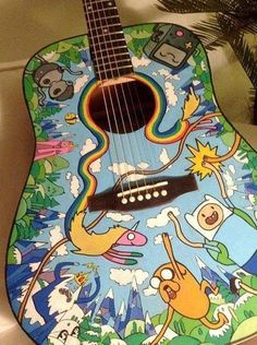 Adventure Time Acoustic Guitar. I would want to learn to play just because this is AMAZING!!! I need this.