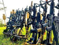 Checkout this gun rack filled with rifles at a 3 gun match.