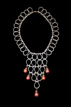 Tear drops     silver tear drops shaped necklace   with pink pearls    Can Be shipped anywhere.