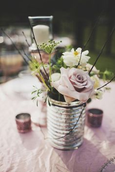 Woodsy Tennessee Wedding. Love the centerpieces made from metal cans.